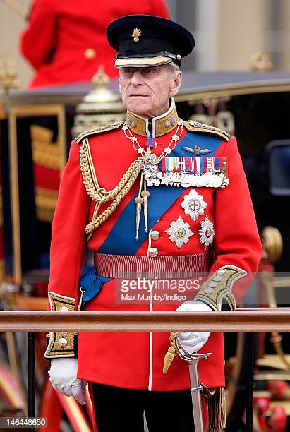 Prince Philip, Duke of Edinburgh stands on a dias to review the troops during the annual Trooping the Colour Ceremony at Buckingham Palace on June...