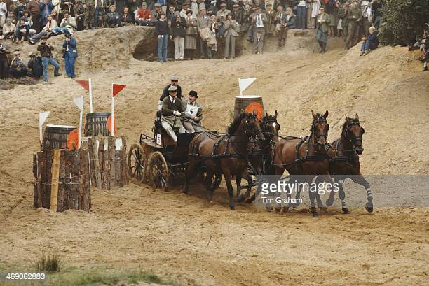 Prince Philip Duke of Edinburgh takes part in the World Carriage Driving Championships in Windsor UK 1980 Here he negotiates the sand pit during an...