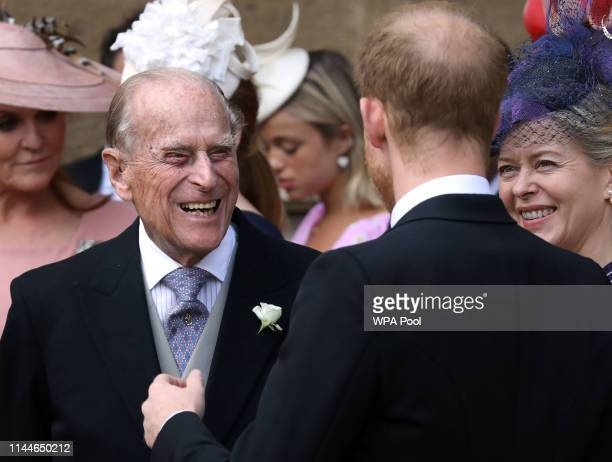 Prince Philip Duke of Edinburgh talks to Prince Harry Duke of Sussex and Lady Helen Taylor as they leave after the wedding of Lady Gabriella Windsor...