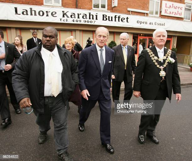 Prince Philip, Duke of Edinburgh tours the Sparkbrook area of Birmingham which was hit by a summer tornado with local resident Rohan Green , and The...