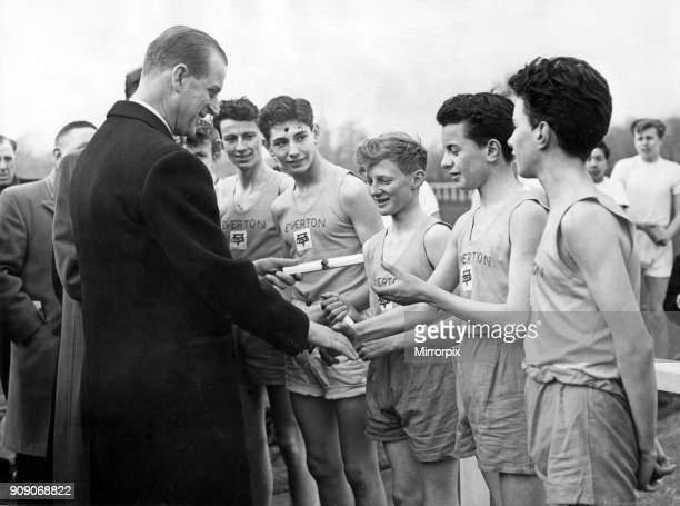 Prince Philip, Duke of Edinburgh, visiting Liverpool. At the Liverpool Boys' Association grounds Prince Philip presents badges and certificates for...