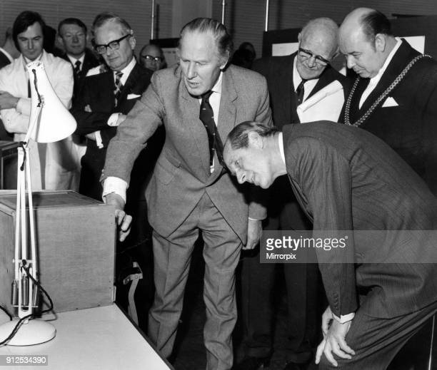 Prince Philip, Duke of Edinburgh visits Liverpool. Dr Alistair Reid shows the Duke a lively snake, one of three which were on display and have the...