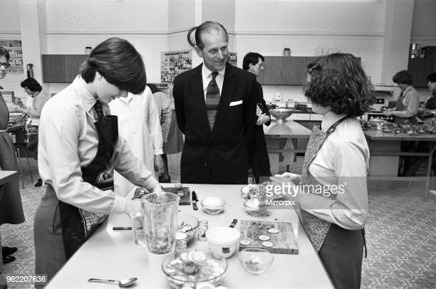 Prince Philip, Duke of Edinburgh visits Malvern Girls College. Isabel Fouall and Loraine Witnall prepare food watched by the Duke, 4th May 1978.