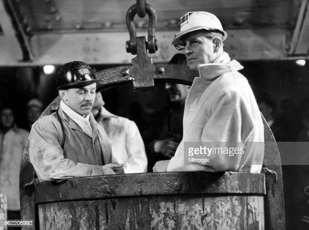 Prince Philip, Duke of Edinburgh visits the Mosley Common Colliery, Lancashire. The Duke rides in a bucket down the 975 yard shaft with Mr C.H...