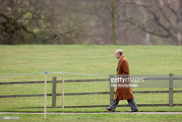 Prince Philip, Duke of Edinburgh walks back to Sandringham House from St. Mary Magdalene Church after attending Sunday service two weeks after...