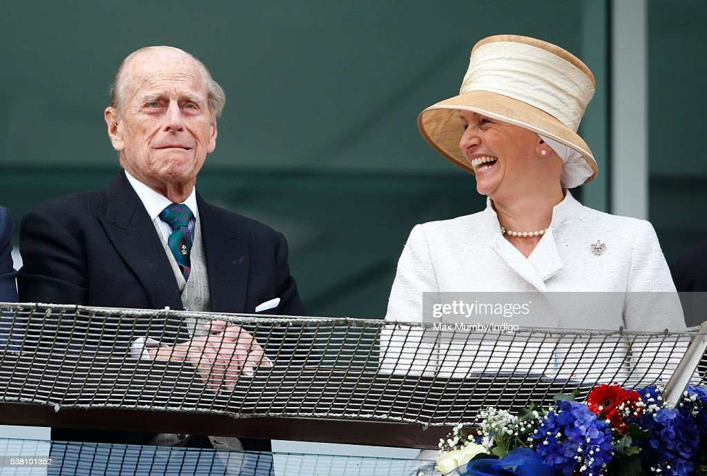 Prince Philip, Duke of Edinburgh watches the racing from the balcony of the Royal Box as he attends Derby Day during the Investec Derby Festival at Epsom Racecourse on June 4, 2016 in Epsom, England.