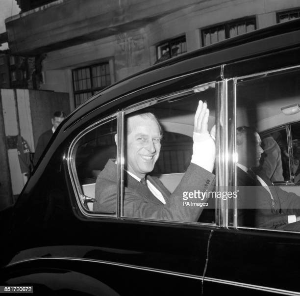 Prince Philip Duke of Edinburgh waves a bandaged hand from window of the car which carried him away from the King Edward VII Hospital for Officers...