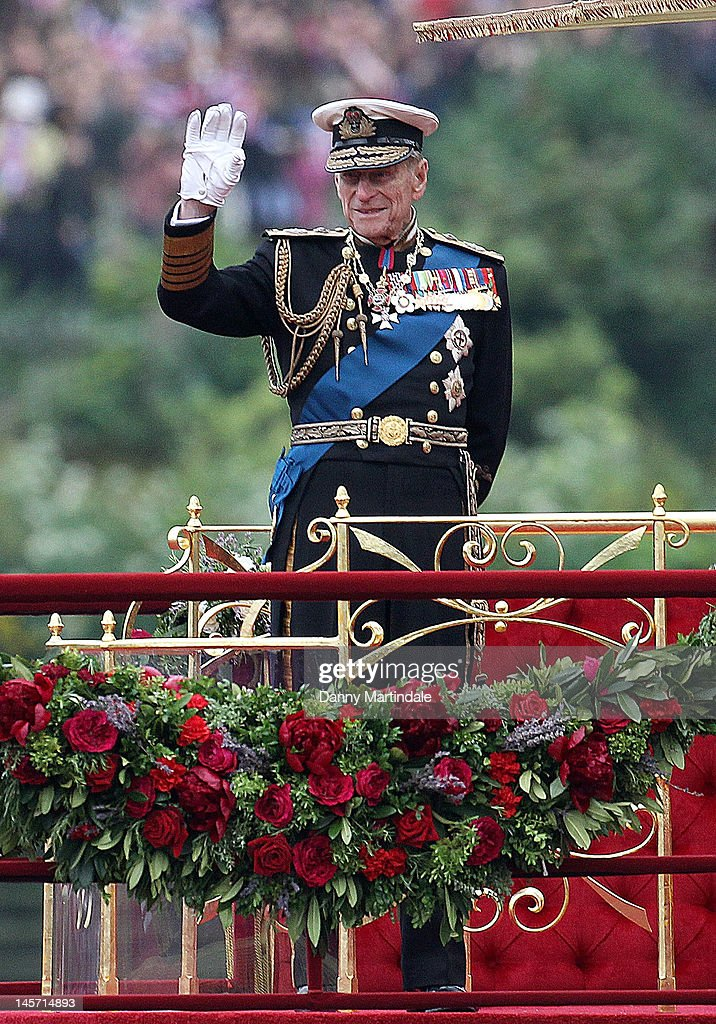 Prince Philip, Duke of Edinburgh waves as he takes part in The Thames River Pageant, as part of the Diamond Jubilee, marking the 60th anniversary of the accession of Queen Elizabeth II on June 3, 2012 in London, England.