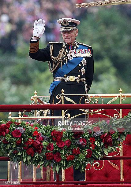 Prince Philip Duke of Edinburgh waves as he takes part in The Thames River Pageant as part of the Diamond Jubilee marking the 60th anniversary of the...
