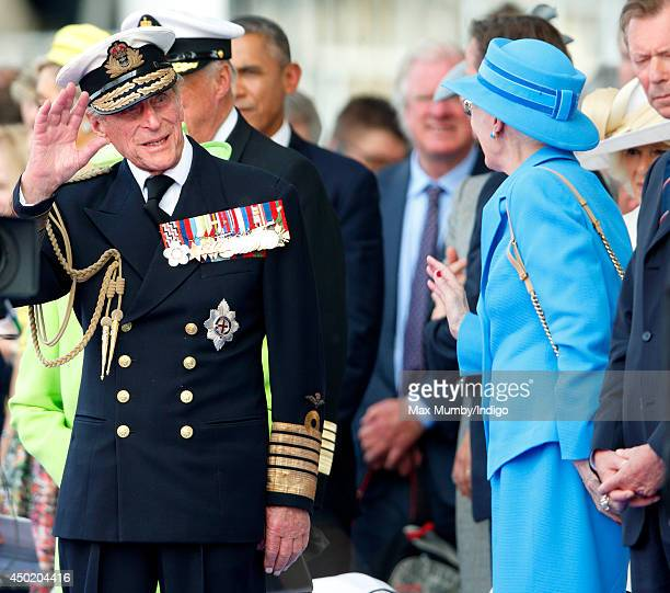 Prince Philip Duke of Edinburgh waves goodbye to Queen Margrethe of Denmark after attending the International Ceremony at Sword Beach to commemorate...