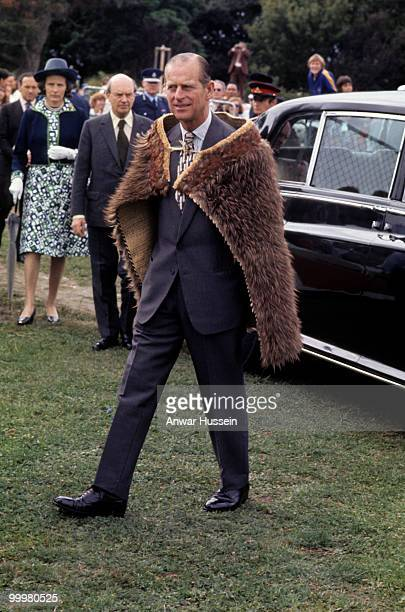 Prince Philip, Duke of Edinburgh wears a kiwi feather cloak as part of the Silver Jubilee Commonwealth Tours in February, 1977 in Gisborne, New...