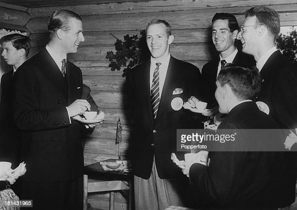 Prince Philip Duke of Edinburgh with members of the Canadian rowing team at a function held during the Olympic Games Helsinki 1952 The Duke has just...