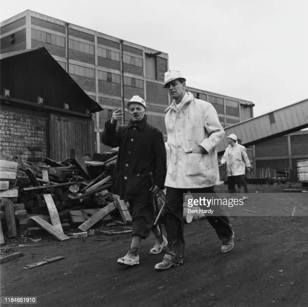 Prince Philip Duke of Edinburgh with Mr H Aspinall manager of numbers 1 and 2 pits at Mosley Common Colliery in Lancashire England 1952 The Duke is...