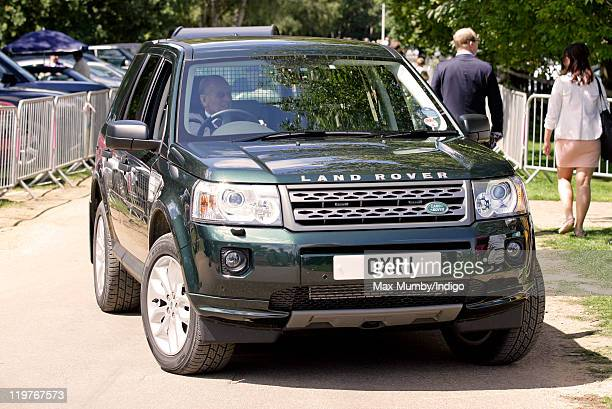 Prince Philip, Duke of Edinburgh,driving his Landrover Freelander four wheel drive, arrives to watch the Cartier International Polo Match at Guards...