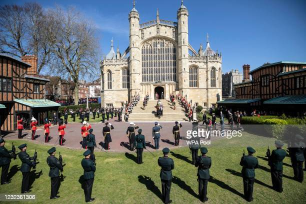 Prince Philip, Duke of Edinburgh's coffin, covered with His Royal Highness's Personal Standard arrives at St George's Chapel carried by a bearer...