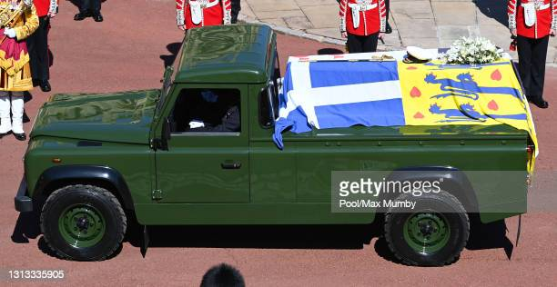 Prince Philip, Duke of Edinburgh's coffin is carried on a specially designed Land Rover Defender hearse during his funeral procession to St. George's...