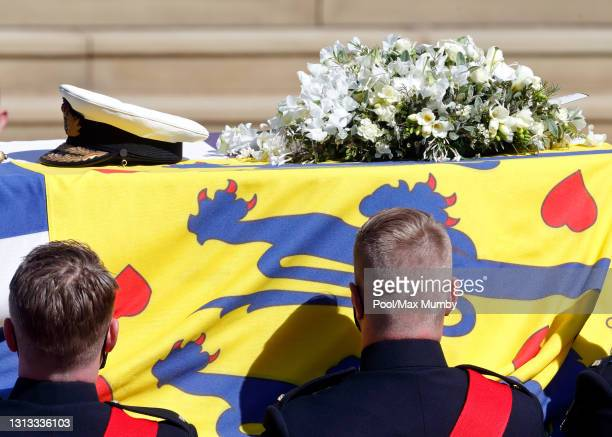 Prince Philip, Duke of Edinburgh's coffin is carried on a specially designed Land Rover Defender hearse to his funeral service at St. George's...