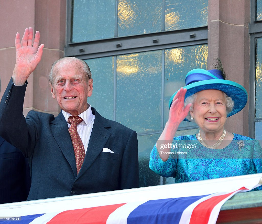 Prince Philip, Duke of Edingburgh and Queen Elizabeth II wave to the crowd from the balcony of the city hall 'Roemer' on June 25, 2015 in Frankfurt am Main, Germany. The Queen and Prince Philip are visiting Frankfurt St. Pauls church and the city hall 'Roemer' during their trip, which is their first to Germany since 2004.