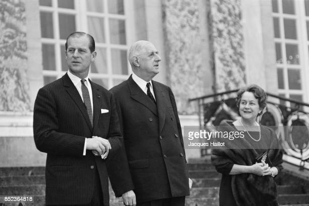 Prince Philip Mountbatten Duke of Edinburgh is welcomed at the Elysee Palace by French President Charles De Gaulle with wife Yvonne