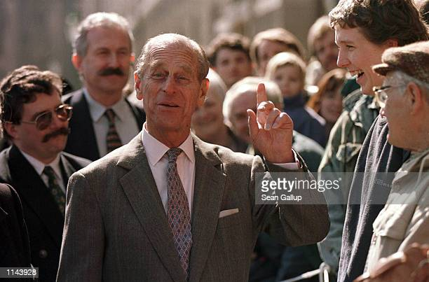 Prince Philip of England shares a laugh with locals during a walking tour of the ancient Czech town of Kutna Hora on the second day of a three day...