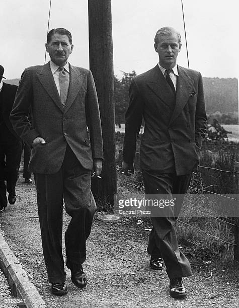 Prince Philip of Greece leaving Crathie Church at Balmoral with Michael Bowes-Lyon, brother of Queen Elizabeth, consort to King George.