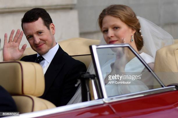 Prince Philip of Serbia also known as Filip Karadjordjevic and his bride Danica Marinkovic leave the Belgrade cathedral after their wedding ceremony...
