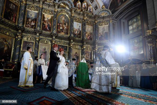 Prince Philip of Serbia also known as Filip Karadjordjevic and his bride Danica Marinkovic attend their wedding ceremony in the Belgrade cathedral on...
