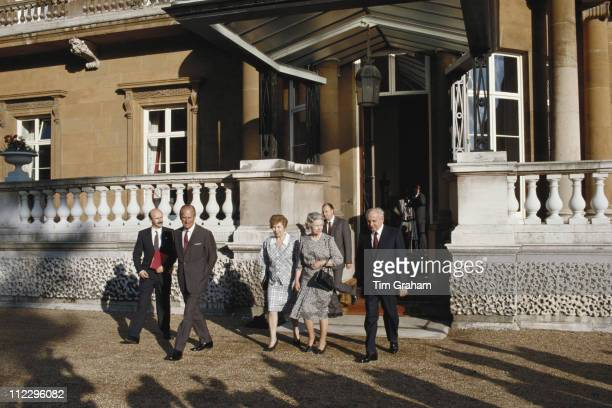 Prince Philip Raisa Gorbachev Queen Elizabeth II and Soviet statesman Mikhail Gorbachev at the Sovereign's Entrance of Buckingham Palace London...