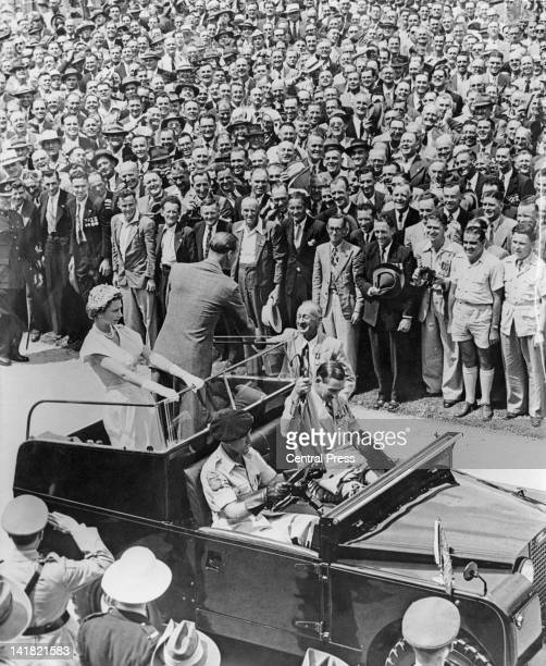 Prince Philip shakes hands with Navy veteran Bill McLellan during a veterans' rally at Brisbane Oval held during Queen Elizabeth II's visit to...
