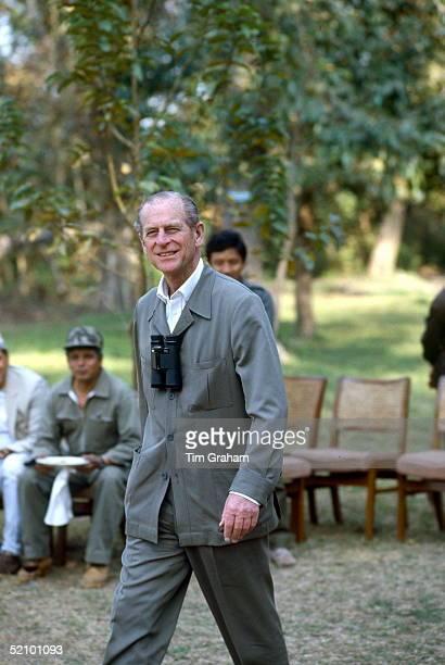 Prince Philip Smiling As He Walks Through Chitwan Park He Has A Pair Of Binoculars Around His Neck