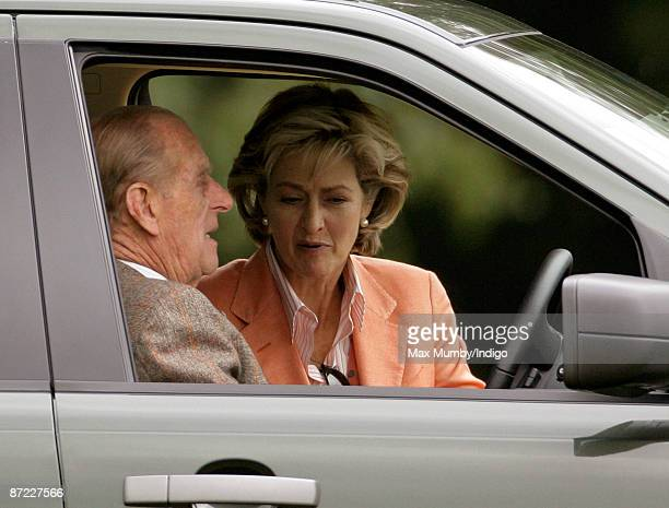 HRH Prince Philip The Duke of Edinburgh and Lady Penny Brabourne watch the driven dressage from the Prince's Landrover during day three of the Royal...