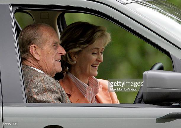 Prince Philip, The Duke of Edinburgh, and Lady Penny Brabourne watch the driven dressage from the Prince's Landrover during day three of the Royal...