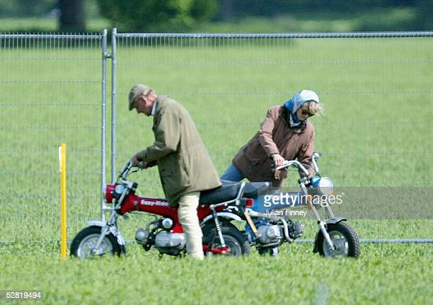 Prince Philip The Duke of Edinburgh and Lady Penny Romsey mount their mini motorbikes during the Royal Windsor Horse Show at Home Park Windsor Castle...