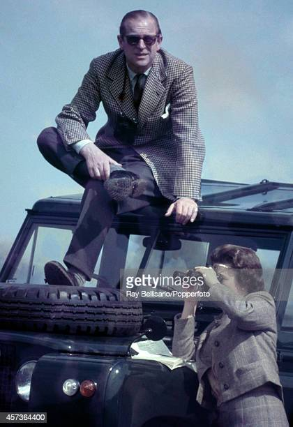 Prince Philip The Duke of Edinburgh atop a Land Rover with Queen Elizabeth II below during the Badminton Horse Trials in Gloucestershire on 20th...