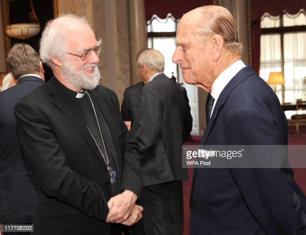Prince Philip The Duke of Edinburgh chats with the Archbishop of Canterbury Dr Rowan Williams during a ceremony at Buckingham Palace to mark the Duke...