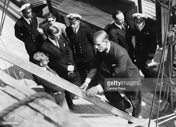 Prince Philip the Duke of Edinburgh climbing a ladder as he visits Aberdovey Training Camp Wales July 1949