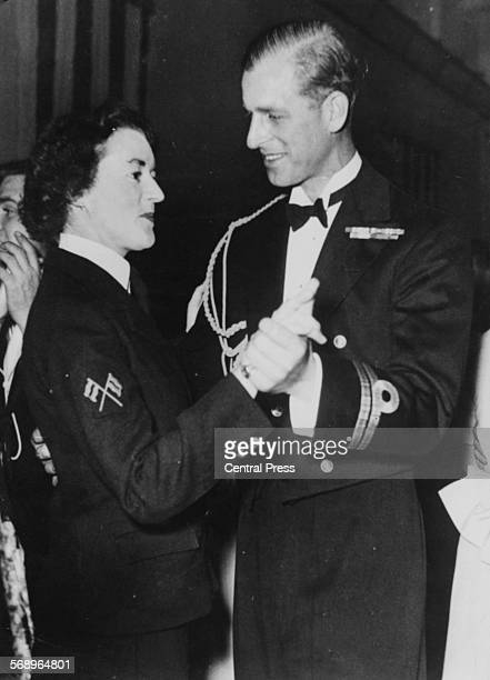 Prince Philip the Duke of Edinburgh dancing with Wren Petty Officer Patricia Kelly aboard the HMS Chequers November 27th 1949