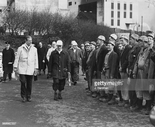 Prince Philip the Duke of Edinburgh is escorted by H Aspinall the manager of Pits 1 and 2 at Mosley Common as they meet a party of miners at the...