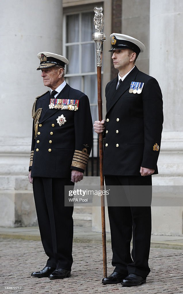 Prince Philip, the Duke of Edinburgh (L) observes a ceremony during a visit to the Admiralty Board and Admiralty House on 23 November, 2011 in London, England. The Duke of Edinburgh was inaugurated as Lord High Admiral as well as formally receiving the Letters Patent, followed by a lunch given by the First Sea Lord at Admiralty House.