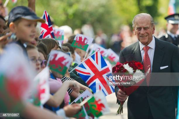 Prince Philip, The Duke of Edinburgh, receives flowers from local children at the Royal Dockyard Chapel during an official visit on April 29, 2014 in...