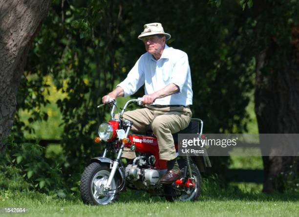 Prince Philip the Duke of Edinburgh rides a monkeybike at the Royal Windsor Horse Show May 16 2002 in Windsor England
