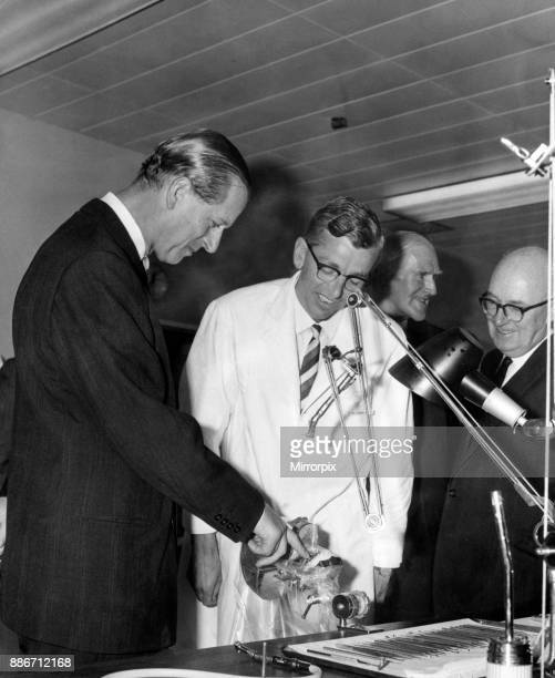 Prince Philip the Duke of Edinburgh risks a finger as he examines a realistically mounted set of teeth during his tour of the Dental School and...