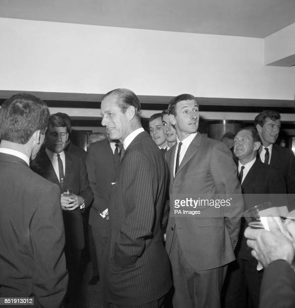 Prince Philip The Duke of Edinburgh talking with members of the Australian cricket touring team at the Savoy Hotel London where a luncheon was being...
