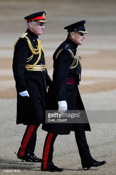 Prince Philip, the Duke of Edinburgh , walks accompanied by Major General William Cubitt, General Officer Commanding London District, after taking...