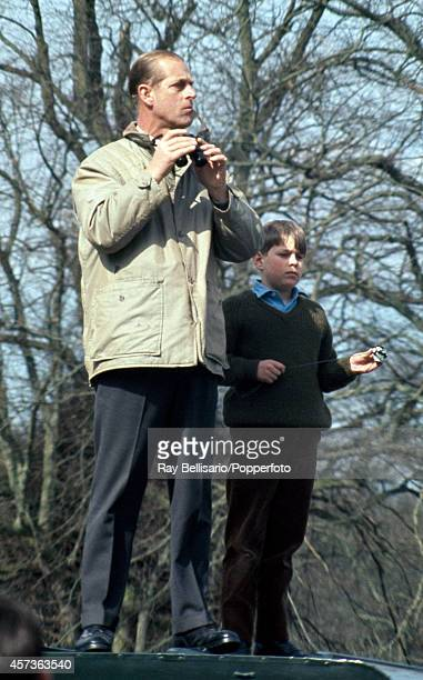 Prince Philip The Duke of Edinburgh with his second son Prince Andrew standing atop a Land Rover during the Badminton Horse Trials in Gloucestershire...