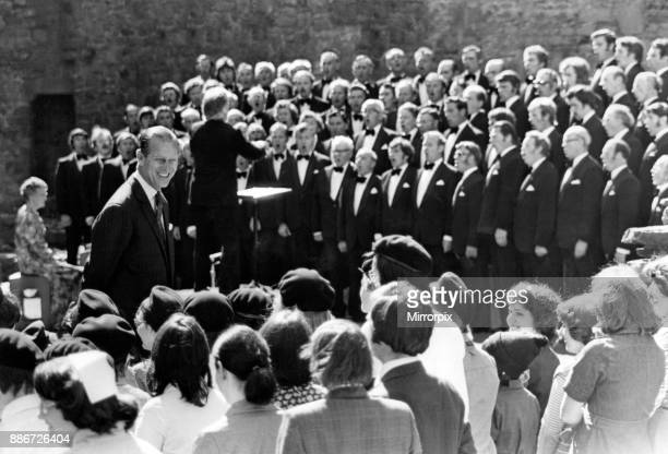 Prince Philip visiting Wales The Duke of Edinburgh smiling at local children as the Brythoniaid choir sings June 1977