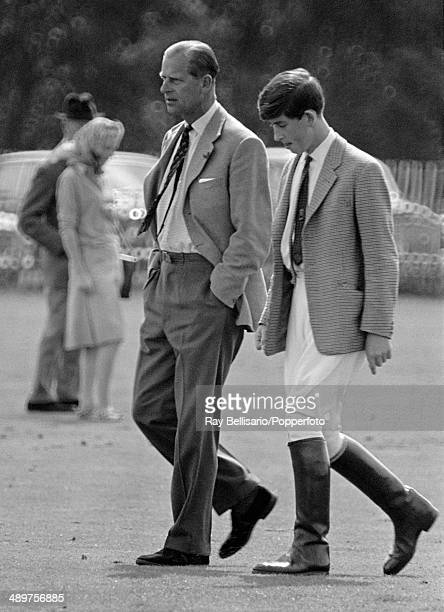 Prince Philip walking with his son Prince Charles at Smith's Lawn in Windsor Great Park on 2nd August 1965