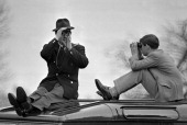 Prince philip with prince charles sitting atop a car and looking in picture id490088249?s=170x170