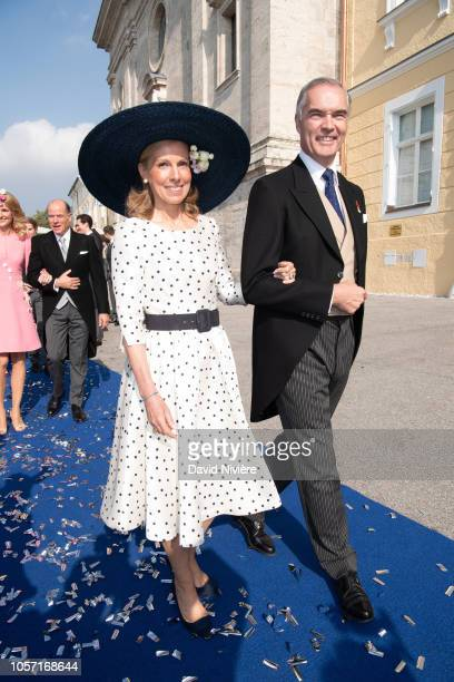 Prince Philipp of Wurttemberg and Countess Marie Adelaide of Andigne leave the SaintQuirin Church after the wedding of Duchess Sophie of Wurttemberg...