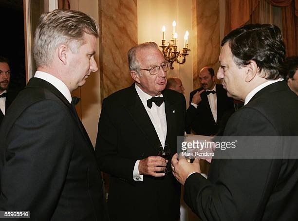 Prince Philippe and King Albert II of Belgium talk with European Commission President Jose Manuel Barroso at a reception at the Cercle Gaulois in...